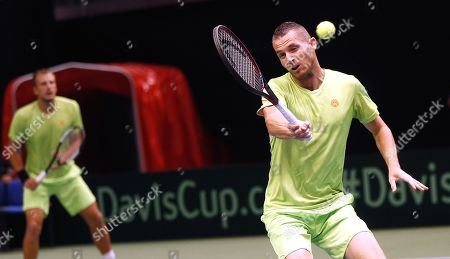 Mirza Basic (R) and Tomislav Brkic (L) of Bosnia in action in action during their double match against Jiri Lehecka and Jiri Vesely of Czech Republic at the Davis Cup Europe/Africa Group I first round tie between Bosnia and Czech Republic in Zenica, Bosnia and Herzegovina, 15 September 2019.