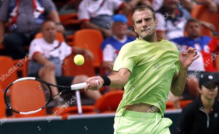 Stock Image of Mirza Basic of Bosnia in action against Jiri Vesely of Czech Republic during the Davis Cup Europe/Africa Group I first round between Bosnia and Czech Republic in Zenica, Bosnia and Herzegovina, 15 September 2019.