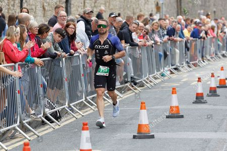 Stock Photo of Former Wales international Shane Williams runs on the South Parade, Tenby