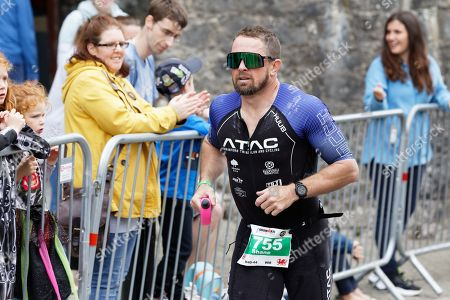 Former Wales international Shane Williams runs on the South Parade, Tenby