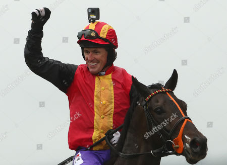 The Pat Smullen Champions Race For Cancer Trials Ireland. Tony McCoy celebrates winning with Quizical
