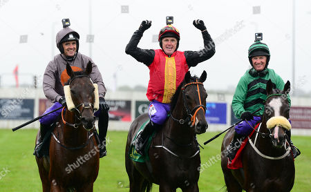 CURRAGH. TONY McCOY on Quizical shows his delight after his win with Ruby Walsh (left) and Paul Carberry on right.