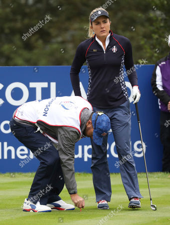 Lexi Thompson of the US has her caddie tee her ball up on the 5th hole during the Sunday Singles match against Europe in the Solheim cup at Gleneagles, Auchterarder, Scotland