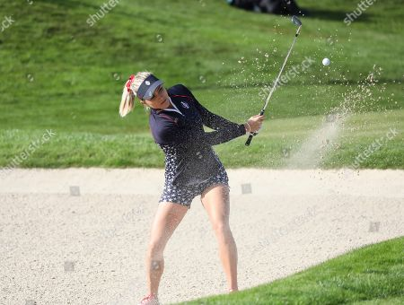 Stock Picture of Lexi Thompson of the US plays from the bunker on the 17th hole during the Sunday Singles match against Europe in the Solheim cup at Gleneagles, Auchterarder, Scotland