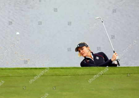 Lexi Thompson of the US plays out of the bunker on the 2nd hole during the Sunday Singles match against Europe in the Solheim cup at Gleneagles, Auchterarder, Scotland