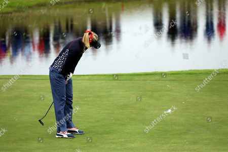 Lexi Thompson of the US holing a putt on the 2nd hole during the Sunday Singles match against Europe in the Solheim cup at Gleneagles, Auchterarder, Scotland