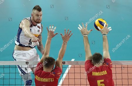 Ivan Zaytsev (L) of Italy in action against Robert Adrian Aciobanitei and Razvan Florentin Mihalcea (R) of Romania during the EuroVolley Men 2019 match between Romania and Italy, in Montpellier, France, 15 September 2019.