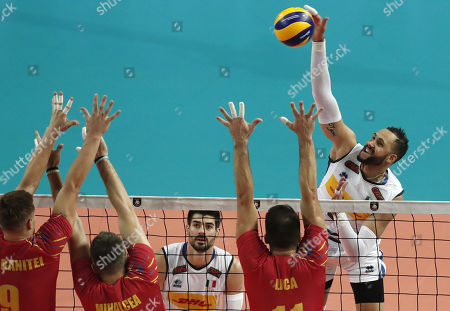 Osmany Juantorena Portuondo (R) of Italy in action against Robert Adrian Aciobanitei, Razvan Florentin Mihalcea and Laurentiu Lica (L) of Romania during the EuroVolley Men 2019 match between Romania and Italy, in Montpellier, France, 15 September 2019.