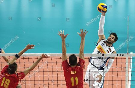 Filippo Lanza (R) of Italy in action against Andrei Spinu and Laurentiu Lica (L) of Romania during the EuroVolley Men 2019 match between Romania and Italy, in Montpellier, France, 15 September 2019.