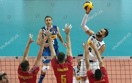 Osmany Juantorena Portuondo (R) of Italy in action against Robert Adrian Aciobanitei, Razvan Florentin Mihalcea and Cristian Bartha (L) of Romania during the EuroVolley Men 2019 match between Romania and Italy, in Montpellier, France, 15 September 2019.