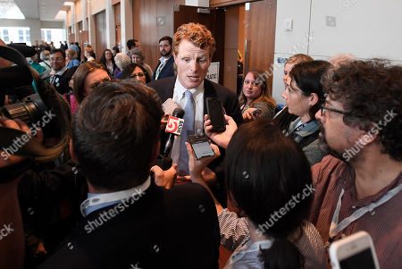 U.S. Rep. Joe Kennedy III, speaks to the media after a panel on race and politics, in Springfield, Mass