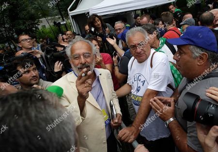 Journalist Gad Lerner speaks with supporters of The League during the party's annual rally in Pontida, northern Italy, . A survey published Sunday in the financial daily il Sole-24 Ore shows that despite Matteo Salvini's political missteps, the League remains the strongest party in Italy with 34% support