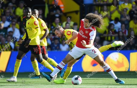 Watford's Tom Cleverley (C) vies for the ball with Arsenal's Matteo Guendouzi (R) during an English Premier League soccer match at Vicarage Road in Watford, Britain, 15 September 2019.