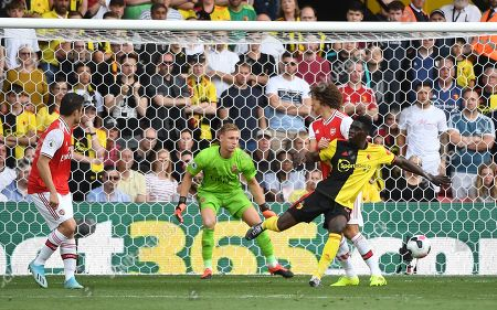 Watford's Ismaila Sarr (R) tries to flick the ball past Arsenal keeper Bernd Leno  during an English Premier League soccer match at Vicarage Road in Watford, Britain, 15 September 2019.
