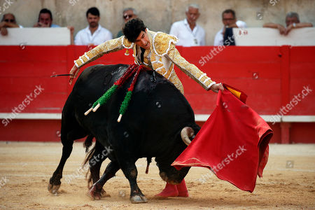 Stock Image of Spanish bullfighter Alberto Lopez Simon fights with a bull during a bullfight held on the occasion of the 'Feria des vendanges' in Nimes, southern France, 15 September 2019. The fair runs from 13 to 15 September.