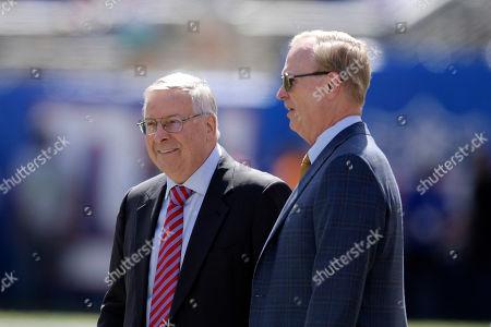 Buffalo Bills owner Terry Pegula, left, and New York Giants owner John Mara talk before an NFL football game, in East Rutherford, N.J