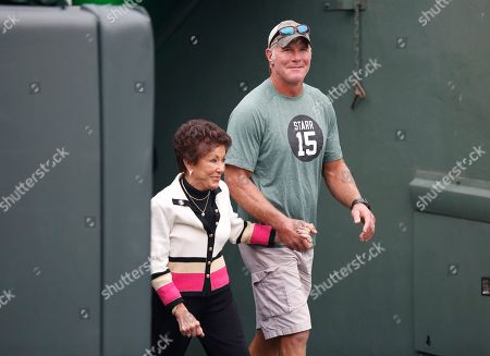 Stock Image of Former Green Bay Packers quarterback Brett Favre escorts Sherry Starr out of the tunnel before an NFL football game between the Green Bay Packers and the Minnesota Vikings, in Green Bay, Wis