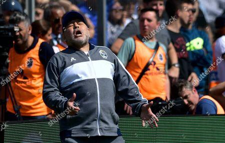 Diego Maradona, head coach of the Gimnasia y Esgrima La Plata soccer team, laments a missed opportunity to score during a local tournament match against Racing Club at Juan Carmelo Zerillo stadium in La Plata, Argentina