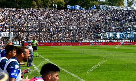 Diego Maradona, head coach of the Gimnasia y Esgrima La Plata soccer team, behind left, stands on the sidelines of his team's local tournament match against Racing Club at Juan Carmelo Zerillo stadium in La Plata, Argentina