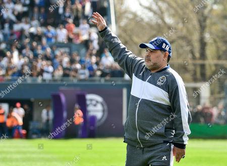 Diego Maradona, head coach of the Gimnasia y Esgrima La Plata, waves prior to his team's local tournament soccer match against Racing Club at Juan Carmelo Zerillo stadium in La Plata, Argentina