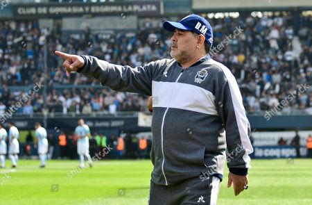 Diego Maradona, head coach of Gimnasia y Esgrima La Plata soccer team, points prior to his team's local tournament match against Racing Club at Juan Carmelo Zerillo stadium in La Plata, Argentina