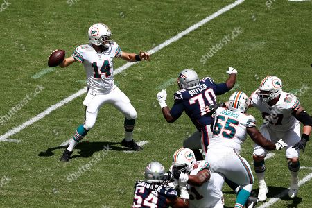 Miami Dolphins quarterback Ryan Fitzpatrick (14) looks to pass, during the first half at an NFL football game against the New England Patriots, in Miami Gardens, Fla