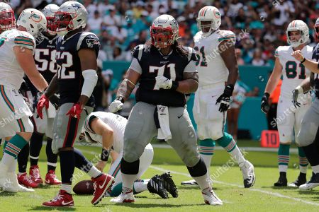 New England Patriots defensive tackle Danny Shelton (71) celebrates after sacking Miami Dolphins quarterback Ryan Fitzpatrick, during the second half at an NFL football game, in Miami Gardens, Fla