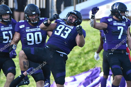 Joe Spivak, Blake Gallagher, Jake Saunders, Travis Whillock. Northwestern defensive lineman Joe Spivak (93) reacts with linebacker Blake Gallagher (51), defensive tackle Jake Saunders (90) and defensive back Travis Whillock (7) after he sacks UNLV quarterback Armani Rogers, during the second half of an NCAA college football game on . in Evanston, Ill