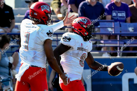 Armani Rogers, Charles Williams. UNLV quarterback Armani Rogers (1) celebrates with running back Charles Williams (8) after Williams scores during the first half of an NCAA college football game against Northwestern on . in Evanston, Ill