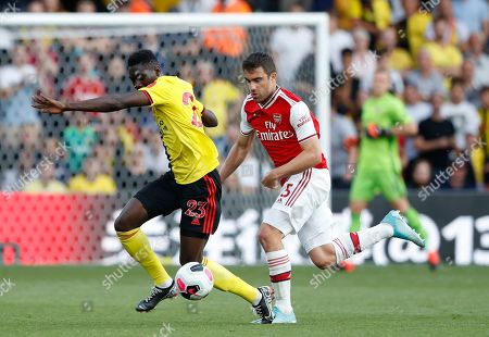 Watford's Ismaila Sarr, left vies for the ball with Arsenal's Sokratis Papastathopoulos during their English Premier League soccer match between Watford and Arsenal at the Vicarage Road stadium in Watford near London