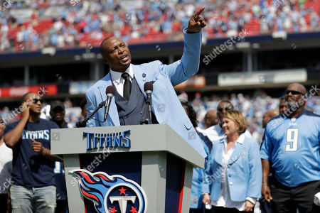 Former Tennessee Titans running back Eddie George speaks as his number 27 is retired during a halftime ceremony at an NFL football game between the Titans and the Indianapolis Colts, in Nashville, Tenn