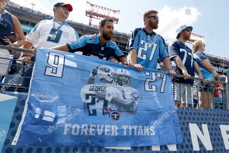 Tennessee Titans fans watch as the numbers of former running back Eddie George and late Tennessee Titans quarterback Steve McNair are retired during a halftime ceremony at an NFL football game between the Titans and the Indianapolis Colts, in Nashville, Tenn