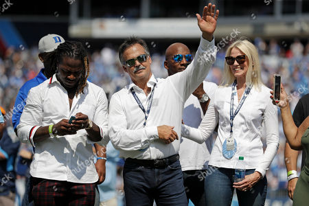 Former Tennessee Titans head coach Jeff Fisher waves to the crowd during a ceremony retiring the numbers of former running back Eddie George and the late quarterback Steve McNair during an NFL football game between the Titans and the Indianapolis Colts, in Nashville, Tenn