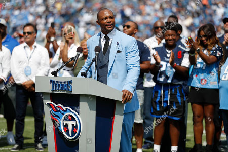 Former Tennessee Titans running back Eddie George speaks during a ceremony retiring his number at an NFL football game between the Titans and the Indianapolis Colts, in Nashville, Tenn