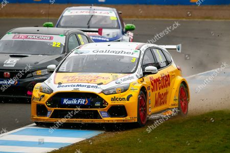 Stock Image of Tom CHILTON Team Shredded Wheat Racing with Gallagher gets too wide coming out of the hairpin and has to go offroad during the Kwikfit British Touring Car Championship at Knockhill Racing Circuit, Dunfermline