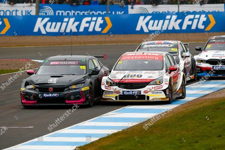 Stock Picture of Josh COOK BTC Racing & Jason PLATO Sterling Insurance with Power Maxed Racing go wheel to wheel coming out of the hairpin on the way up to the finish line during the Kwikfit British Touring Car Championship at Knockhill Racing Circuit, Dunfermline