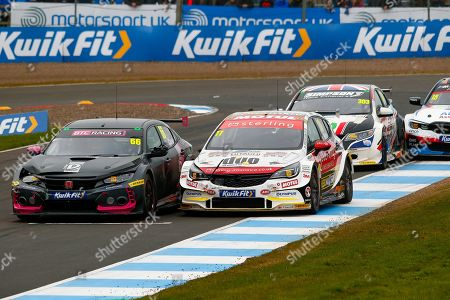 Stock Image of Josh COOK BTC Racing & Jason PLATO Sterling Insurance with Power Maxed Racing go wheel to wheel coming out of the hairpin on the way up to the finish line during the Kwikfit British Touring Car Championship at Knockhill Racing Circuit, Dunfermline