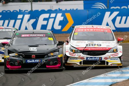 Stock Photo of Josh COOK BTC Racing & Jason PLATO Sterling Insurance with Power Maxed Racing go wheel to wheel coming out of the hairpin on the way up to the finish line during the Kwikfit British Touring Car Championship at Knockhill Racing Circuit, Dunfermline