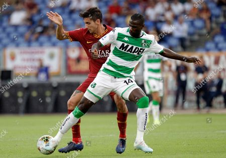 Roma's Lorenzo Pellegrini, left, vies for the ball with Sassuolo's Pedro Obiang during a Serie A soccer match between Roma and Sassuolo, in Rome