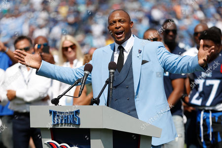 Stock Picture of Former Tennessee Titans running back Eddie George speaks as his number 27 is retired during a halftime ceremony at an NFL football game between the Titans and the Indianapolis Colts, in Nashville, Tenn
