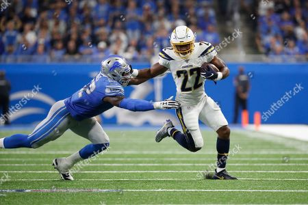 Los Angeles Chargers running back Justin Jackson (22) runs the ball against the Detroit Lions in the second half of an NFL football game in Detroit