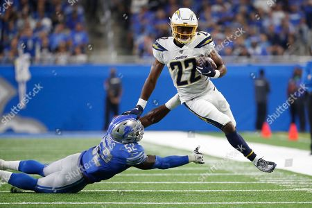 Los Angeles Chargers running back Justin Jackson (22) runs the ball as Detroit Lions outside linebacker Christian Jones (52) defends in the second half of an NFL football game in Detroit
