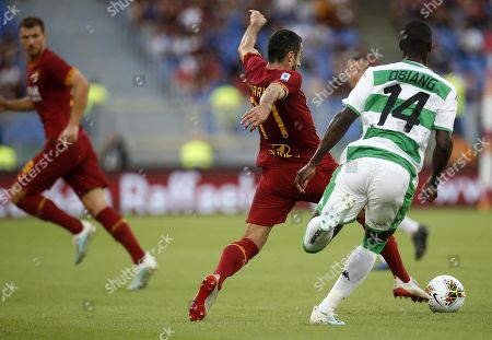 Roma's Henrikh Mkhitaryan (L) in action against Sassuolo's Pedro Obiang (R) during the Serie A soccer match between AS Roma and US Sassuolo at the Olimpico Stadium in Rome, Italy, 15 September 2019.