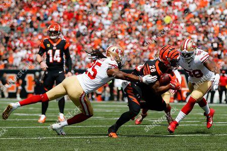Cincinnati Bengals running back Joe Mixon (28) runs the ball against San Francisco 49ers cornerback Richard Sherman (25) during the first half an NFL football game, in Cincinnati