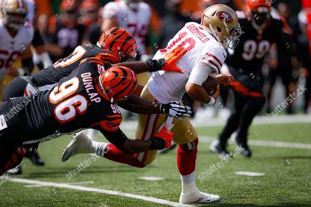 San Francisco 49ers quarterback Jimmy Garoppolo (10) runs the ball against Cincinnati Bengals defensive end Carlos Dunlap (96) during the first half an NFL football game, in Cincinnati