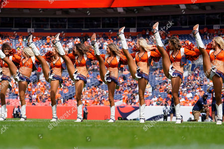 The Denver Broncos cheerleaders perform prior to an NFL football game against the Chicago Bears, in Denver