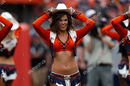 The Denver Broncos cheerleaders perform during the second half of an NFL football game against the Chicago Bears, in Denver