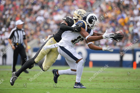 Stock Picture of New Orleans Saints cornerback Eli Apple, left, breaks up a pass intended for Los Angeles Rams wide receiver Robert Woods during the first half of an NFL football game, in Los Angeles