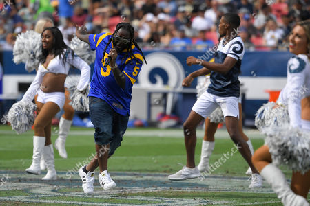 T-Pain performs during half-time during an NFL football game between the Los Angeles Rams and the New Orleans Saints, in Los Angeles