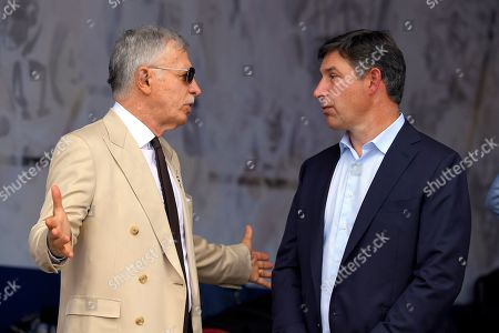 Los Angeles Rams owner Stan Kroenke, left, talks with SoFi CEO Anthony Noto during an NFL football game, in Los Angeles. The personal finance company formally known as Social Finance has reached a 20-year agreement for the naming rights to the multibillion-dollar stadium complex in Inglewood, Calif